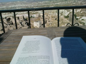 My copy of 'Foucault's Pendulum' overlooking the Pigeon Valley from the rooftop at Has Konak in Cappadocia